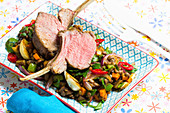 Rare lamb chops on a lentil medley with fresh chillis