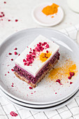 A slice of raspberry panna cotta cake with turmeric