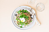 Spaghetti with lemon sauce, purslane and a poached egg