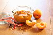 Apricot and ginger chutney with fresh chili in a mason jar