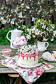Blossom cake with strawberry white chocolate in a garden