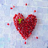 Pomegranate Heart on White Background