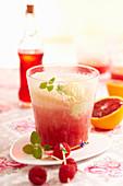 Blood orange cocktail with vanilla ice cream