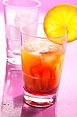 A Tequila Sunrise made with lemon juice, orange juice and grenadine