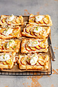 Puff pastry tarts with marzipan and peaches, mascarpone on top