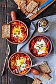 Baked egg with chorizo, pepper and tomato