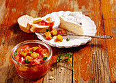 Mango and tomato relish with soft cheese