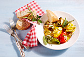 Grilled, pickled Mediterranean vegetables on a plate with a napkin