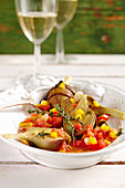 Young pickled artichokes with tomatoes, peppers, vinegar, oil, lemon, white wine and spices