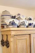 Old stoneware crockery on top of farmhouse cupboard
