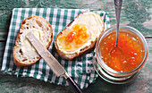 Grapefruit jam with ginger on buttered bread