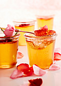 Jars of rose jelly with rose petals