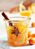 A jar of exotic spiced jam with kumquats, star fruit, star anise and cinnamon