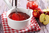 Nectarine and apple jam in a saucepan on a napkin
