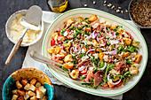 Cherry tomatoes, arugula, serrano ham and croutons salad with parmesan