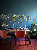 Garland of eucalyptus branches above festively set table