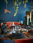 A festively laid table in dark colours