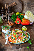 White cabbage salad with vegetables and yogurt dressing