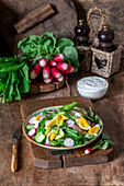 Raw vegetable salad with boiled eggs