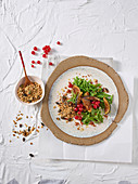 Bean salad with figs, currants, bacon and oatmeal and pumpkin seed granola