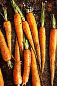 Roasted young carrots on a baking tray