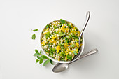 Tabbouleh with green and yellow peppers