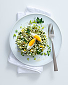 Rice and bread salad with capers, parsley, onion and egg