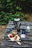 Breakfast on a wooden table outdoors