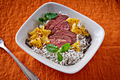 Duck with pineapple, rice and mint