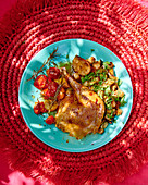 Chicken leg with tomatoes and garlic