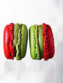 Two red and green macarons