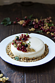 Panna cotta cake garnished with gooseberries and redcurrants