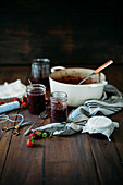 Homemade strawberry jam on a rustic wooden table