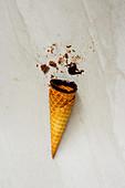 Chocolate sauce dipped ice cream waffle cone