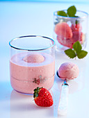 Strawberry and coconut smoothie shake with a scoop of strawberry yoghurt ice cream