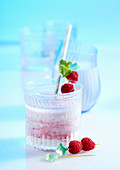 Raspberry and cranberry smoothie with kefir, quark and lime