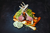 Roasted saddle of lamb with a herb crust and root vegetables