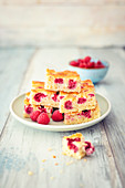 Juicy tray bake cake with raspberries and almonds