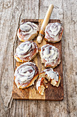 Cinnamon buns topped with cream cheese