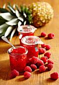 Jars of pineapple and raspberry jam
