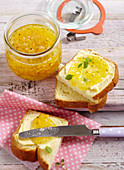 Courgette and pineapple jam in a jar and on a slice of brioche