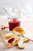 Sour cherry jam with raspberries on bread rolls with butter
