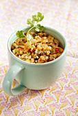 Homemade papaya relish with fresh coriander in a big mug