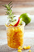 Pineapple chutney with lime, chilli and rosemary in a mason jar