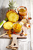 Pineapple chutney with curry in glass jars