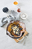 Dutch baby pancake with cream and blueberries