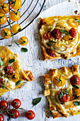 Cheese and tomato puff pastry tarts