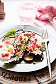 Grilled eggplant with red currants