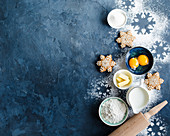 Christmas or New Year food background. Baking ingredients, snowflake cookies