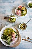 Salad with avocado-wasabi hummus and pistachio dukkah